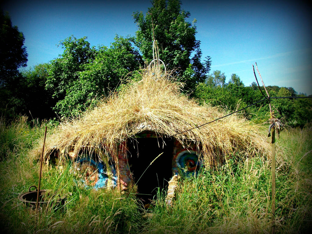 celtic roundhouse grass roof in the green garden by gangahimalaya