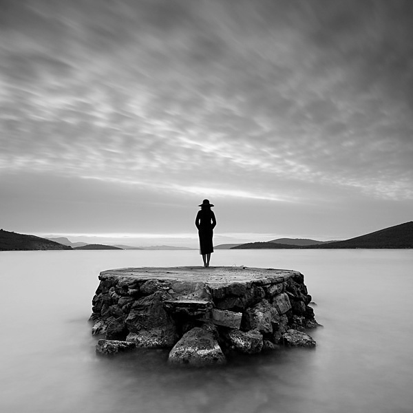 solitude image woman on rock solitude_by_serhatdemiroglu
