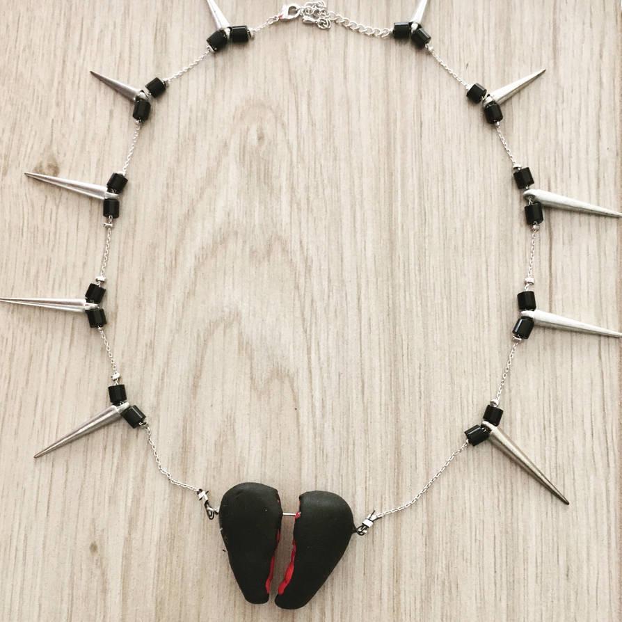 The broken heart necklace  by DragonFan656