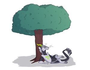 Big fluffy gremlin under a tree