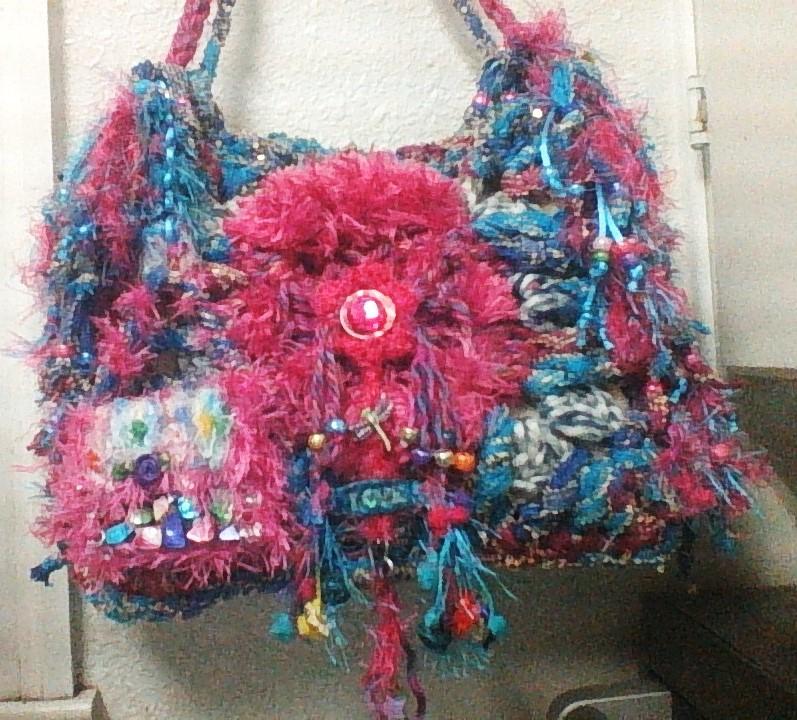 Interchangable embellishments front of purse. by gothidgaf