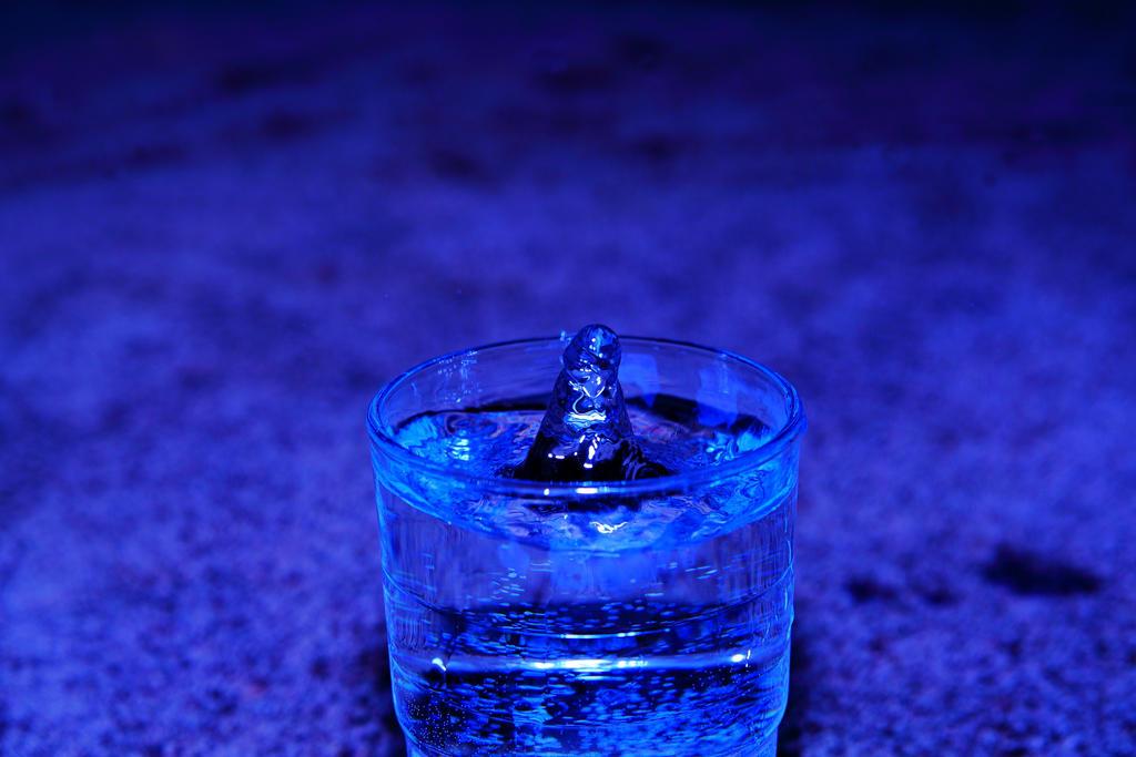 Storm in water glass by mariusjellum