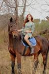 Kristina riding on horses
