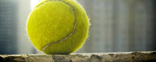 Tennis ball 2560x1024 by dimichael