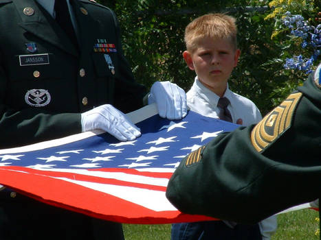 Young Boy Observes a Funeral