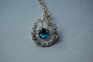Turquoise bead wire wrapped pendant by EatThatCookie