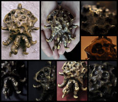 Ancient Spanish Necropolis Cthulhu Cult Amulet by mortonskull