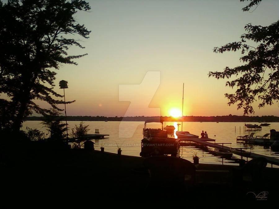 Sunset on Portage Lake by MidknightStarr