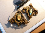 On my bench - two bronze brooches