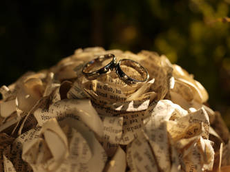 Wedding rings on paper roses by chibicthulhu