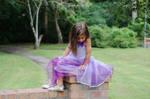 Ella purple dress sitting pose 4