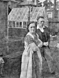 Couple in front of greenhouse by delph-ambi