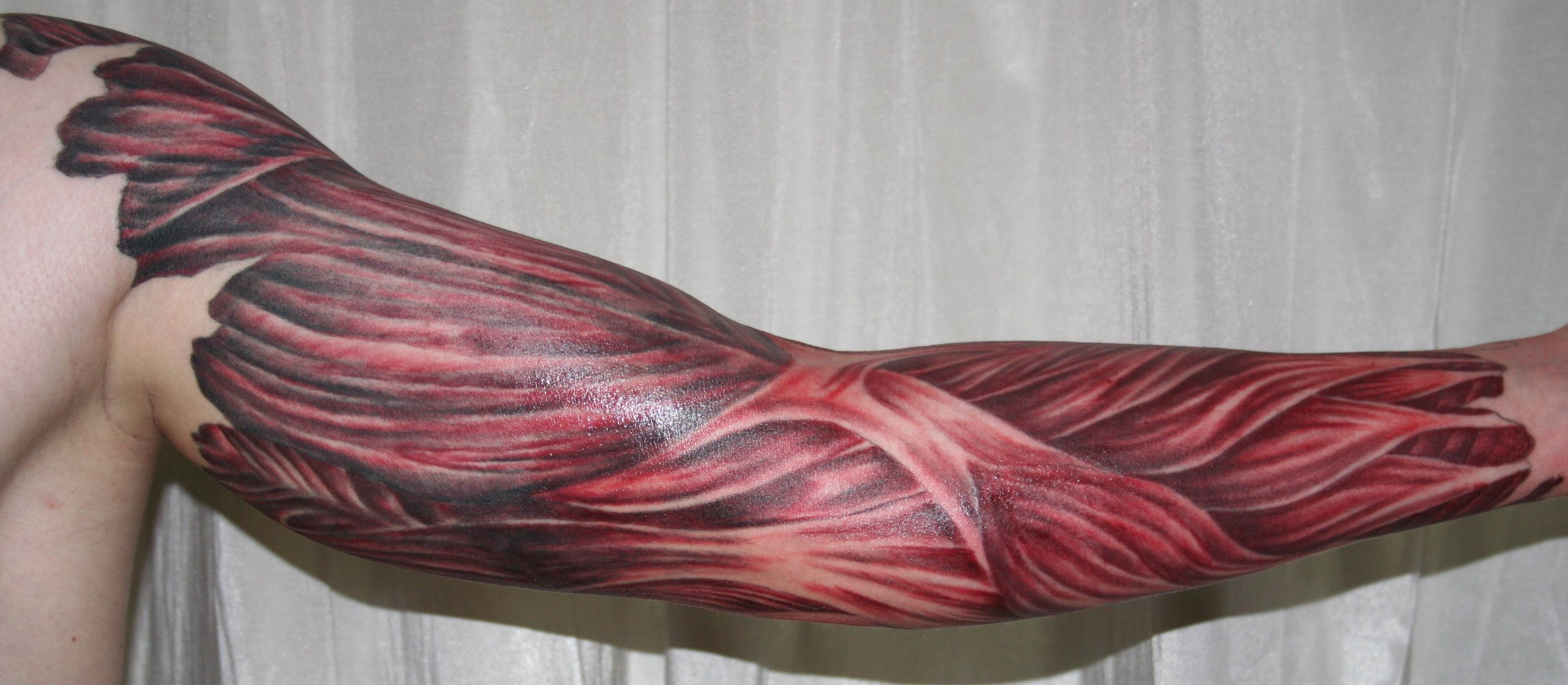 arm with muscle tissue5 Tattoo by 2Face-Tattoo