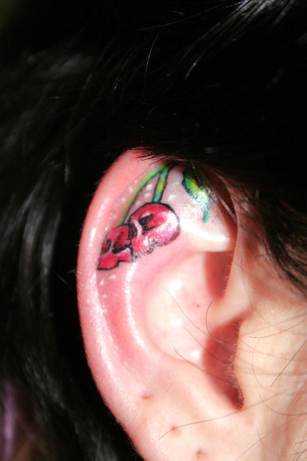 Cherry Ear Skull Tattoo