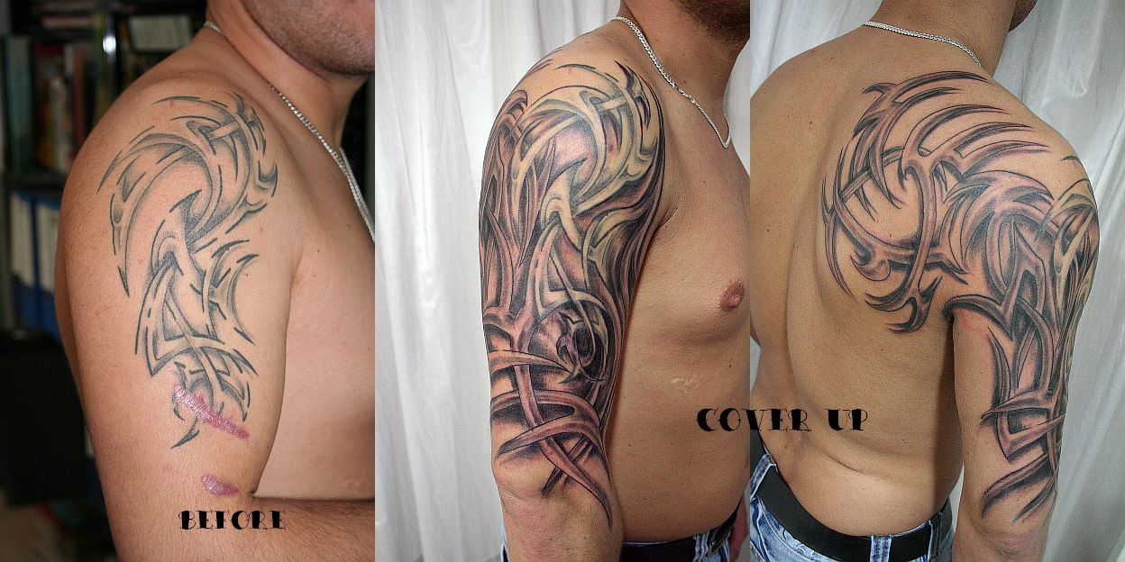 tattoo tribal sleeves. tribal half sleeve tattoos.