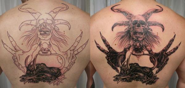 Skull Hand Face Tattoo