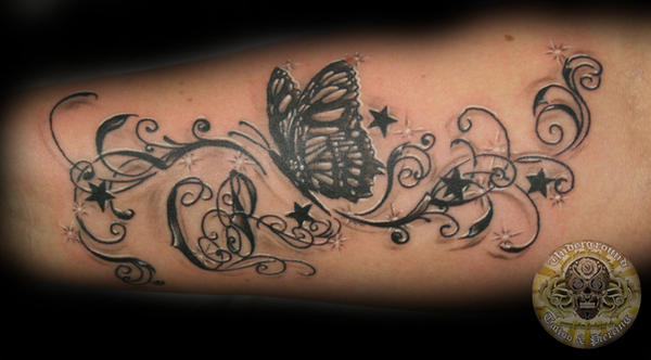 Butterfly chicano style tat