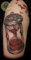 Blood clock script skulls tat