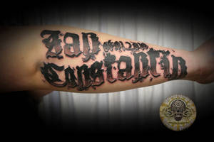 lettering of a son by 2Face-Tattoo