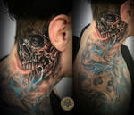 Crazy Skull behind the ear tat