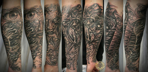 sleeve biomech skull faces fin by 2Face-Tattoo