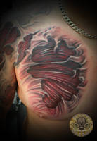 muscle tissue chest tattoo by 2Face-Tattoo