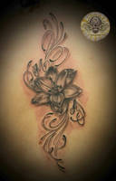 Realistic Lily Tattoo by 2Face-Tattoo
