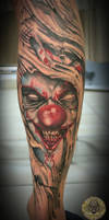 Joker face out of the skin tat