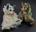 Two resin dragon-foxes