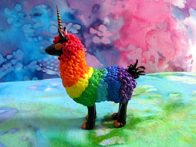 rainbow_llamacorn_by_simonfinch-d5iu4f0.jpg