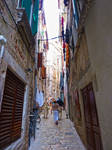Rovinj_Narrow street with hang out clothes