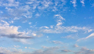 Half Moon in the Clouds