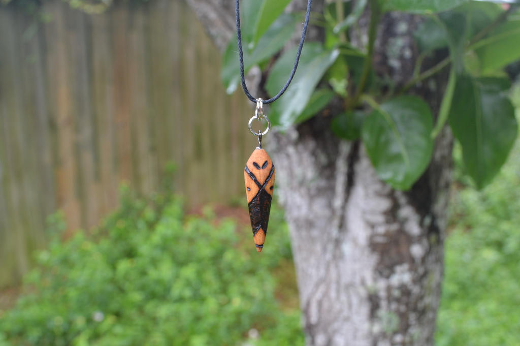 bug/alien pendant by ThinkerOfThoughts