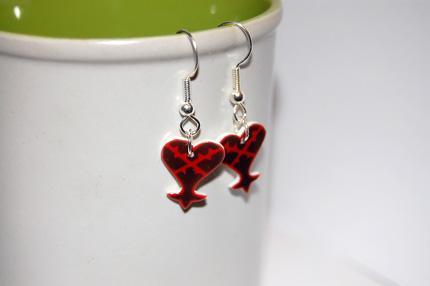 Heartless logo earrings by knil-maloon
