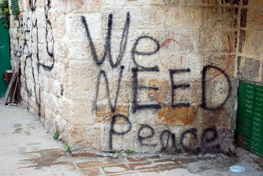 "graffiti from Jerusalem: black spray-painted words, ""We NEED Peace"""