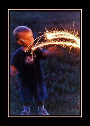 Little Boy With Sparkler by RavenPhotography
