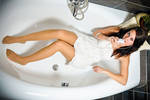 Brunette in the tub