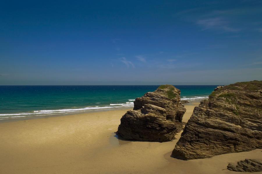 Playa de las Catedrales by dolcesunset