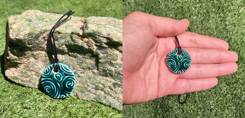 Teal ceramic swirling pendant by EleCeramiche