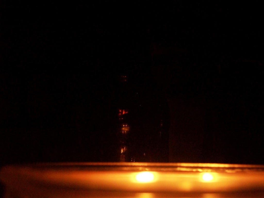 Glass in candle light. by Transformerbrett97