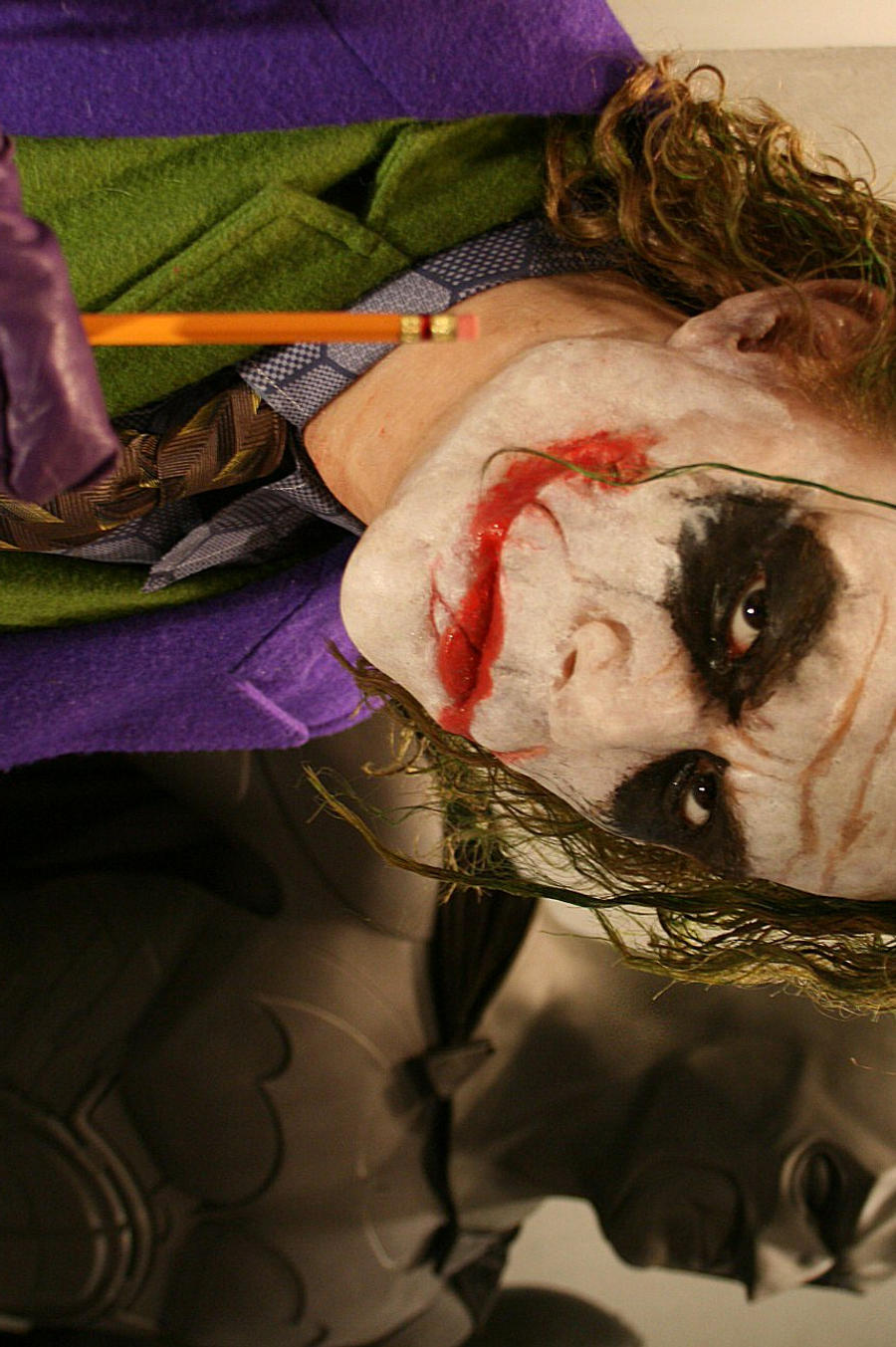 figura HEATH LEDGER como el JOKER