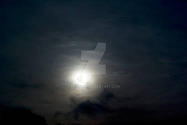 Full moon through dark clouds