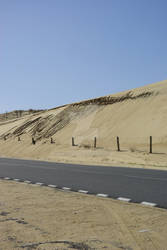 Isolated road along dunes
