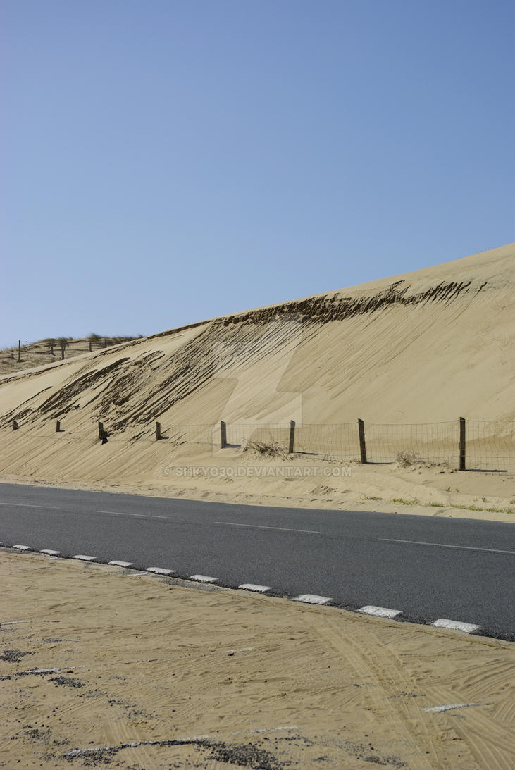 Isolated road along dunes by shkyo30