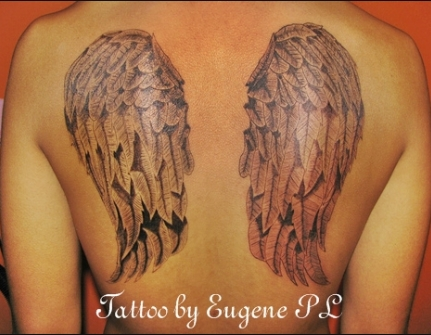Wings on back tattoo by