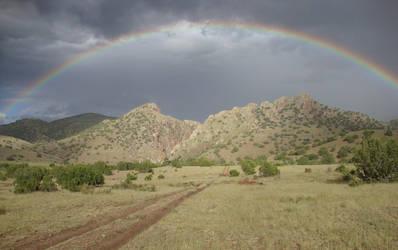 Rainbow Over Monticello Canyon by Erronius
