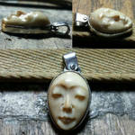 Mammoth tooth face pendant from 3 angles