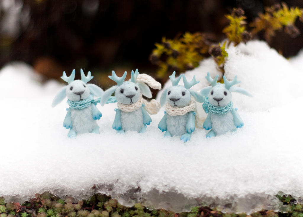 snow and blue jackalopes by freedragonfly