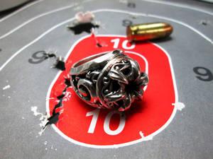 .45 caliber signet ring.