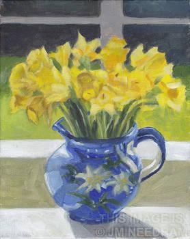 Backlit Daffodils in Blue Vase